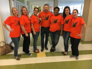 World Language teachers wearing orange t-shirts