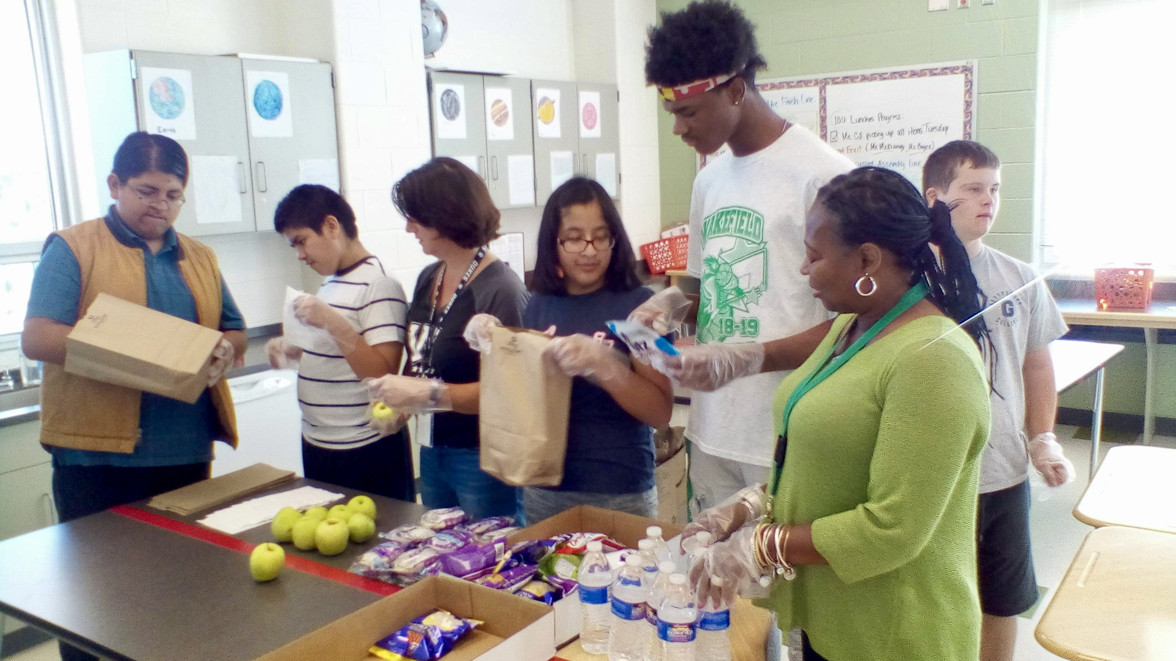 Life Skills Students and Staff Bag Meals for Veterans on the Rise